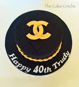 Chanel black and gold cake